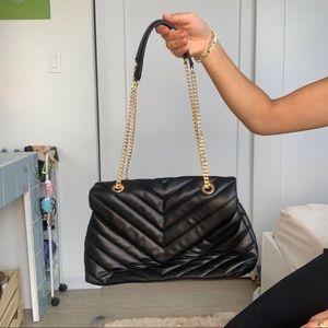 Black purse with adjustable strap